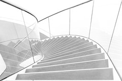 Left turn (Maerten Prins) Tags: blackandwhite white abstract black netherlands monochrome up lines museum stairs composition stair curves nederland rail indoor down stairwell minimal line highkey railing minimalism curve zwolle fundatie