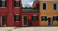 The colors of Burano (Sorin Popovich) Tags: door venice sky italy sunlight house reflection window horizontal architecture clouds outdoors photography day village pastel eu multicoloured tranquility nopeople burano veneto buildingexterior colourimage