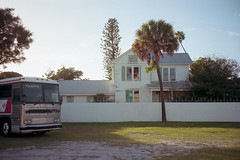 (patrickjoust) Tags: fortpierce florida tampa bus house fujicagw690 kodakportra160 6x9 medium format 120 rangefinder 90mm f35 fujinon lens manual focus analog mechanical c41 color negative patrick joust patrickjoust south fl usa us united states north america estados unidos autaut palm tree home lot auto automobile vehicle