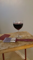 Painting a wall is a lot more fun after a glass of whine (Unmarriedswede) Tags: red wall painting apartment wine whine