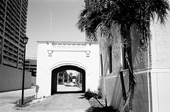 Entrance Miami Womans Club (Phillip Pessar) Tags: camera bw white black film club analog 35mm freedom minolta florida kodak miami places historic national register dual womans tx400