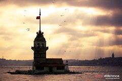 Maiden Tower (Dibrova) Tags: city travel sunset sea cloud lighthouse tower water silhouette turkey cityscape sundown seagull gull dramatic landmark istanbul mosque calm medieval east maritime historical nautical middle orient beacon sunbeam tranquil maiden turkish bosphorus marmara galata destinations kizkulesi leanders