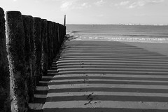 Groynes and Shadow (FraJH Photos) Tags: shadow sea beach netherlands strand zee schaduw groynes breskens golfbreker 2013