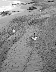 Aloneness (lulleizar2012) Tags: bw man beach sand alone footprints towel calm meditation calmness
