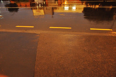 DSC_6860 [ps] - MacAdam's Sea (Anyhoo) Tags: road blue newzealand urban orange reflection wet tarmac yellow slick dusk pavement nz wellington northisland raining kerb curb seam lowsun wakefieldstreet anyhoo photobyanyhoo