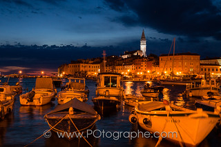Rovinj (Istria, Croatia) fishing harbour at dusk.