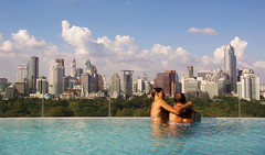 Bangkok from Sofitel So (Kokkai Ng) Tags: people skyscraper sunny luxuryhotel swimwear twopeople sky bikini blonde maturecouple bangkokprovince modern luxury highup tourism tourist travel holiday vacations traveldestinations skyline cityscape pool infinitypool hotel sofitel bangkok thailand asia southeastasia blue cloud male female couple man woman city lookingatview relaxing day horizontal elevatedview builtstructure buildingexterior rooftop water cloudy placeofinterest caucasian sofitelso