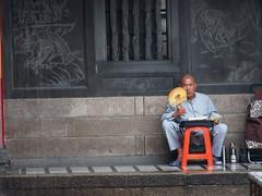 A buddhist munk inside Lungshan Temple, Taipei!