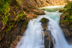 Parted in the middle (Raoul Pop) Tags: longexposure autumn cliff mountains fall colors stone austria waterfall moss rocks afternoon stones rapids falling lichen cascade shrubs krimml osttirol krimmlerwasserfalle at