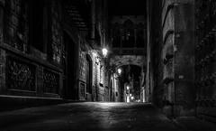 Down a Dark Street (tony.wish) Tags: barcelona street city longexposure nightphotography blackandwhite building lamp monochrome architecture night mono spain nikon europe gothic historic gothicquarter hdr bnw barrigotic d5300