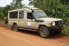 Grounded (My photos live here) Tags: africa road broken truck canon eos flat nowhere going down vehicle uganda landcruiser tyre unpaved 1000d
