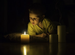 The Last Candle (Phillip Haumesser Photography) Tags: light boy childhood blackbackground mystery night dark kid candles child naturallight nighttime mysterious imagination candlelight littleboy storytime