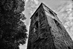 Bell tower... (henryark) Tags: sky blackandwhite italy tree tower church monochrome architecture clouds high stones perspective belltower campanile tuscany middle ages borgo enrico medioevo montecatini nannini valdinievole monoart henryark