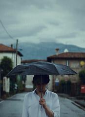 Raindrops (Alice Consonni) Tags: street boy portrait man rain umbrella photography photo nikon cloudy outdoor alice young rainy portraiture raindrops d80 nikond80 consonni