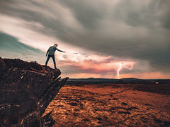 Domination - III (ThibaultPoriel) Tags: portrait sky people cloud mountain france mountains montagne landscape rocks europe domination bretagne stormy olympus ciel nuage paysage extrieur epic trolltunga