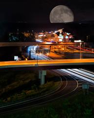 The Lonely Road (yeahbouyee) Tags: road moon cars night lights highway traffic rush hour roadway lightstreams vertorama yeahbouyee