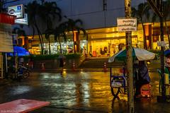 Monsoon in Bangkok (dominiquesainthilaire) Tags: rain night umbrella thailand nikon pluie monsoon nuit silom thailande parapluie mousson averse vendeur nikond7100