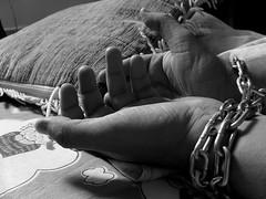 Prisoner with chain around hands (JobsForFelonsHub) Tags: white black chains hands chain shackles around wrist prisoner inmate