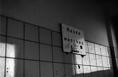 The enjoyment of public restrooms (Tiefengeist) Tags: 50mm kodak tmax 14 delta nikonf100 100 ilford kodaktmax ilforddelta100 kodaktmaxdeveloper14 sigma50mmf14exdghsm