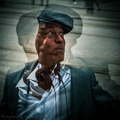 Two Faced (Fiverdog) Tags: street portrait music man manchester streetphotography multipleexposure headphones blackman dragan suave dapper splittone twofaced draganeffect maninhat buryphotographicsociety burypsstreetsig buryps
