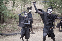 Wild Boys (GlobalGoebel) Tags: africa 3 boys youth canon tanzania eos costume sticks native mark african iii feathers teenagers anger tribal angry chase 5d facepaint adolescent customs 70200mm puberty mark3 markiii canonef70200mmf28lisusm