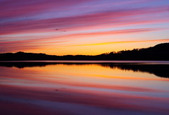 Nordic sunset (Kalsjon) Tags: sunset orange seascape reflection silhouette landscape sweden stripes nordic sverige jmtland stjmtland