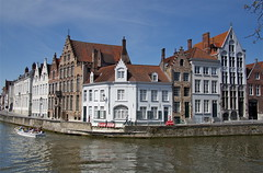 A canal in Bruges (judi may) Tags: blue houses sky people water architecture buildings boat canal belgium bruges