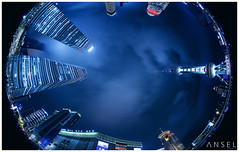 Kid in a Big City (draken413o) Tags: china vertical night digital mall long exposure skyscrapers shanghai cityscapes fisheye pearl oriental ifc circular blending