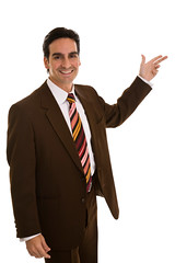 Businessman gesturing with fingers, isolated on white background (anchor1203) Tags: portrait male men sign vertical businessman standing person slim adult gesturing indoor business whitebackground ceo studioshot copyspace manager pointing youngadult directing success leadership isolated lookhere adultsonly necktie metrosexual frontview 20s welldressed youngmen realpeople 2530years 2025years handsign colorimage malebeauty lookingatcamera fullsuit onlymen onemanonly businessperson isolatedonwhite professionaloccupation expressingpositivity