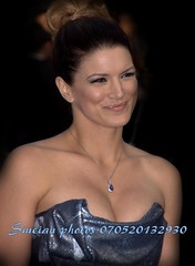 Gina Carano (iron_smyth48) Tags: red portrait woman white celebrity film smile face female hair carpet model glamour eyes dress event actress earrings premiere celeb americangladiators martialartist