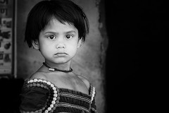 indomitable (Handheld-Films) Tags: travel portrait people blackandwhite india film girl face female mono power indian photojournalism documentary negativespace portraiture strength dignity reportage confidence villagegirl assurance ruralindia countrygirl assured