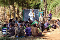 Students learn both in classrooms and outdoors when there is insufficient classroom space. ETHIOPIA