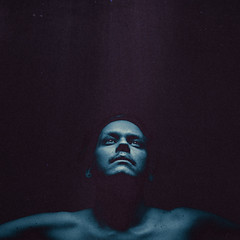 Cover (self) (John Andreas Godwin) Tags: blue light portrait selfportrait face umbrella self 35mm canon dark neck studio nose eyes underwater skin metallic space flash grain magenta floating shoulders noise universe collarbone selfie clavicle