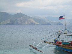 A Flag Tattered But Unbowed (michaelbueza) Tags: boat philippineflag zambales anawangin caponesisland
