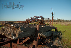 The Wobbly Boot Camp (pie fan pauly) Tags: wood old camping camp plants green grass fence wire bush rust structures australia plough d90