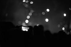 HandyAugustusPlatz (MrSleepyhead) Tags: party blackandwhite mobile night analog handy nikon phone fireworks streetphotography leipzig augustusplatz newyearseve rodinal schwarzweiss 3200 f5 ilforddelta400 1100 feuerwerk 2h nikonf5 standdevelopment handyfoto standentwicklung nikon50mmafd14