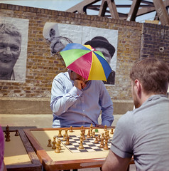 (333Bracket) Tags: street playing game men london 120 6x6 film umbrella mediumformat board chess analogue bricklane hasselblad501cm kodakporta400 333bracket planarcb80mmf28