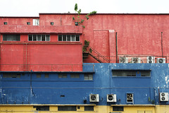 Federal Cinema (Andrew Tan 2011) Tags: old red plant building window yellow wall architecture stairs fan paint decay side malaysia kuala kl aircon rectangle lumpur compressor ventilation rectangular paintwork