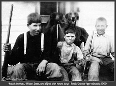 Walter, Jessie, and Alfred Katsch with Hounds - South Dakota approx. 1900 (crelison) Tags: southdakota brothers hunting 1900 suspenders hounddogs katsch huntingrifle sittingonporch