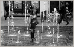 Fountains fixation (* RICHARD M (5 million views)) Tags: street wet water fountain monochrome liverpool mono blackwhite candid fascination fountains candids fixation fixated merseyside fascinated williamsonsquare enthralled mesmerised footballkit capitalofculture soccerkit inawe europeancapitalofculture footballstrip fountainfixation soccerstrip