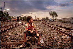 0001_zoriah_cambodia_train_track_slums_20131116_8171 (Zoriah) Tags: poverty sunset train photo war cambodia photographer child picture documentary conflict phnompenh crisis slum reportage photojournalist disasters zoriah