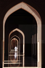 Arcade light (Elios.k) Tags: door camera travel november light shadow people white man color colour reflection building travelling tourism vertical architecture canon dark walking outdoors person photography one sandstone gate asia arch exterior open dress floor walk muslim islam traditional side religion arcade perspective arc middleeast belief style courtyard mosque cap arab frame opening local marble arabian peninsula oman muscat islamic portico headdress kuma grandmosque sahn dishdasha omani sultanate sultanqaboos masqat riwaq bawshar 5dmkii