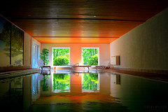 The Pool (Neal J.Wilson) Tags: windows orange green water pool swimming buildings reflections germany still squares shapes swimmingpool walls hotels sunbeds
