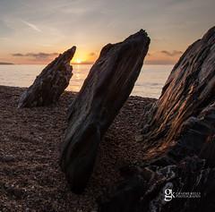 Schist Sunrise (GraemeKelly) Tags: light sea seascape sunrise landscape photography coast landscapes rocks devon graeme kelly sands slapton schist graemekellyphotography