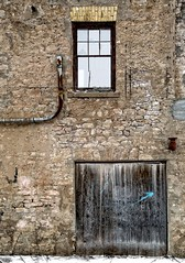 A Relic Of The Past (Paul Berkloo) Tags: ca door wood old ontario canada building brick texture abandoned window rock stone wall architecture ancient alley outdoor stonework elora relic