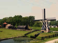 Dutch nostalgic scene (STEHOUWER AND RECIO) Tags: trees holland bird mill water netherlands windmill dutch grass architecture fence buildings reflections landscape scenery view path wildlife nederland scene nostalgic gras uitzicht egret enkhuizen molen hollands reiger vogel gebouwen nostalgisch
