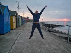 The Sheringham Star (World of Izon) Tags: sunset sea man norfolk beachhuts sheringham starjump
