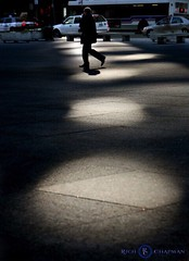 One from the vault Foot Lights A man walks across Daley Plaza in Chicago through a pattern of light reflections from a nearby building. (Photo by Rich Chapman) (richchapmanphoto) Tags: plaza light usa chicago illinois pattern loop rich pedestrian daley spotlights richchapman richchapmanphotographers