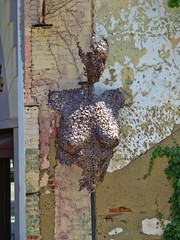 Metal sculpture of a woman at Elm and Washington Streets. (dckellyphoto) Tags: sculpture statue bust face metal building brick female woman breasts breast profile ivy partial 2016 exterior greensboronc greensboro greensboronorthcarolina northcarolina outdoor
