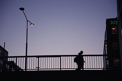 Overhead Crossing (Florian Btow) Tags: bridge light sunset people lamp backlight person evening soft sweden stockholm railing shiluette